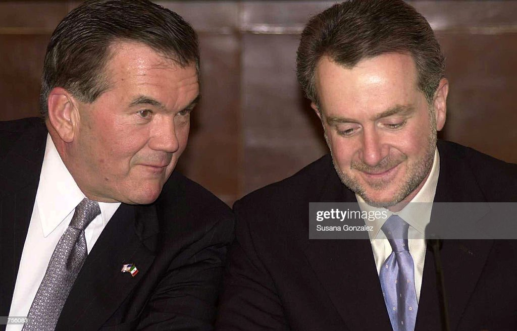 S Homeland Security Director Tom Ridge and Mexico's Interior Secretary Santiago Creel talk before a conference March 5 2002 in Mexico City Mexico...