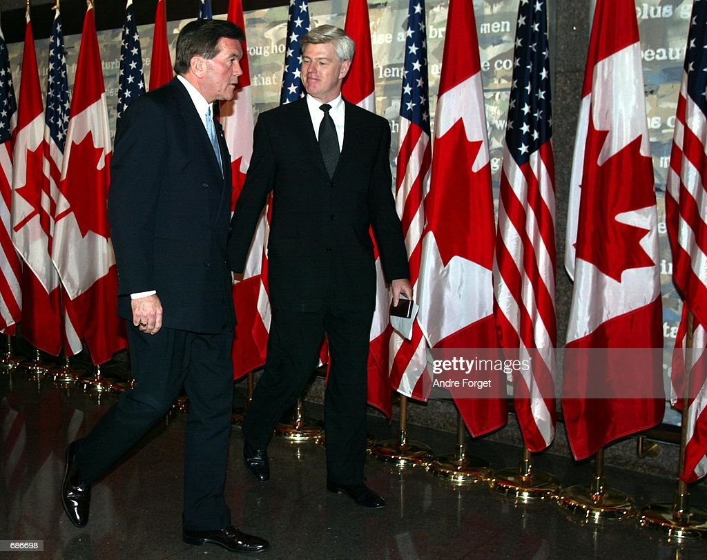 Homeland Security Director Tom Ridge exits a press conference with Canadian Foreign Minister John Manley December 11 2001 in the capital city of...