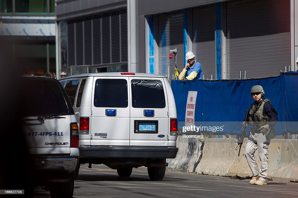 A Homeland Security Federal Protective Services Police (FPS) officer guides a van outside of the John Joseph Moakley United States Courthouse in Boston, Massachusetts, U.S., on Wednesday, April 17, 2013. Investigators have video of a possible suspect in the Boston Marathon bombings though no one is under arrest in the case, according to federal law enforcement officials. Photographer: Scott Eisen/Bloomberg via Getty Images