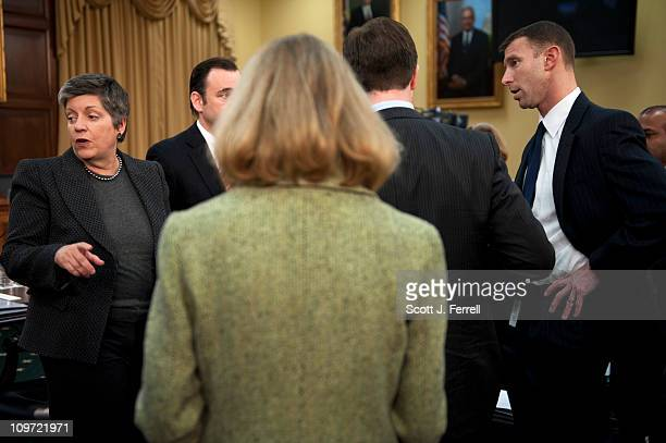 Homeland Security Secretary Janet Napolitano far left waits with aides for the start of the House Appropriations Subcommittee on Homeland Security...