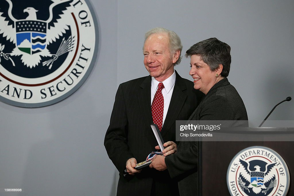 Homeland Security Secretary <a gi-track='captionPersonalityLinkClicked' href=/galleries/search?phrase=Janet+Napolitano&family=editorial&specificpeople=589781 ng-click='$event.stopPropagation()'>Janet Napolitano</a> (R) presents Senate Homeland Security and Governmental Affairs Committee Chairman Sen. Joseph Leiberman (I-CT) with the Secretary's Award during a ceremony at the at the U.S. Citizenship and Immigration Services December 19, 2012 in Washington, DC. Lieberman, who is retiring after 24 years in the U.S. Senate, was recognized by Napolitano for his 'advocacy and leadership on behalf of the Department of Homeland Security and the country and for helping to ensure the safety and security of the American people.'