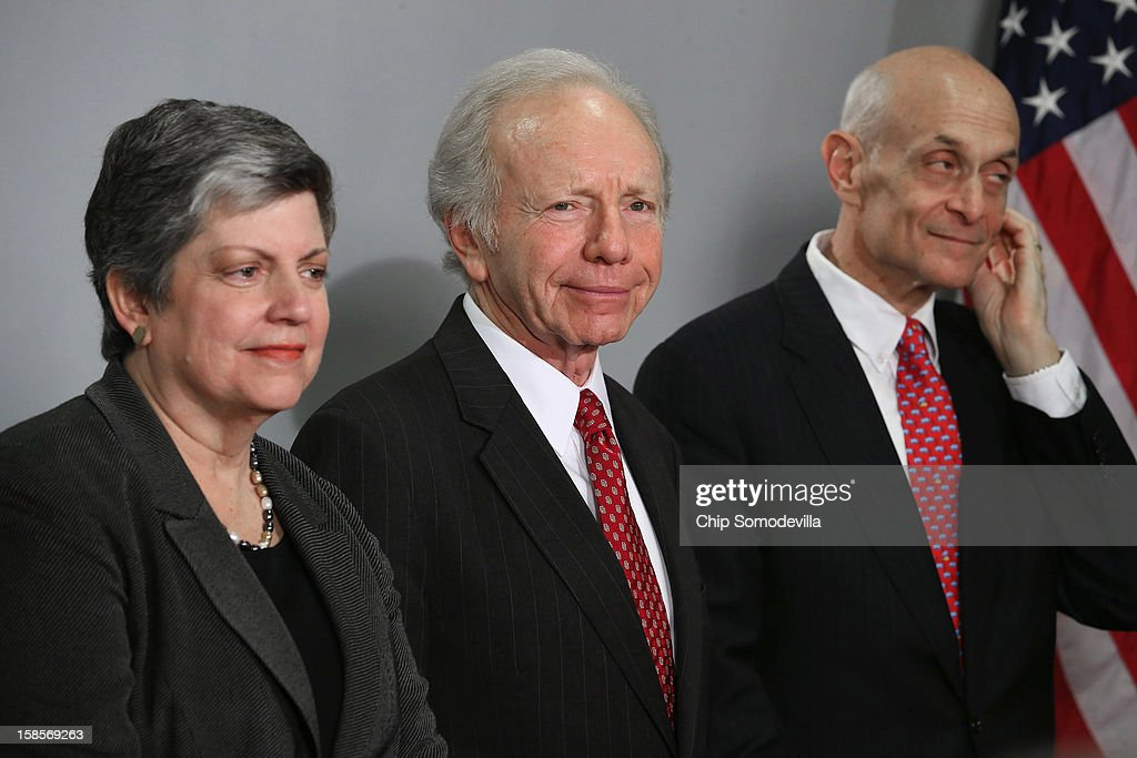 Homeland Security Secretary <a gi-track='captionPersonalityLinkClicked' href=/galleries/search?phrase=Janet+Napolitano&family=editorial&specificpeople=589781 ng-click='$event.stopPropagation()'>Janet Napolitano</a>, Senate Homeland Security and Governmental Affairs Committee Chairman Sen. Joseph Leiberman (I-CT) and former DHS Secretary <a gi-track='captionPersonalityLinkClicked' href=/galleries/search?phrase=Michael+Chertoff&family=editorial&specificpeople=204729 ng-click='$event.stopPropagation()'>Michael Chertoff</a> participate in a ceremony honoring Leiberman at the U.S. Citizenship and Immigration Services December 19, 2012 in Washington, DC. Lieberman, who is retiring after 24 years in the U.S. Senate, was recognized by Napolitano for his 'advocacy and leadership on behalf of the Department of Homeland Security and the country and for helping to ensure the safety and security of the American people.'