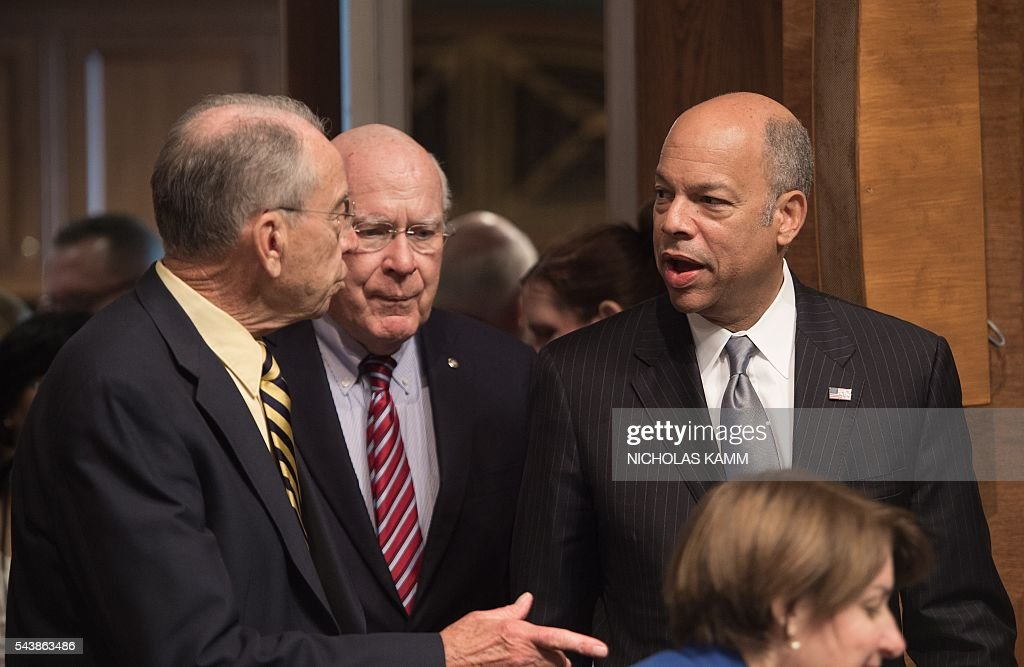 Homeland Security Secretary Jeh Johnson speaks with Senate Judiciary Committee chairman Senator Chuck Grassley of Iowa (L) and Ranking Member Senator Patrick Leahy of Vermont as he arrives to testify at a hearing on Oversight of the Department of Homeland Security on Capitol Hill in Washington, DC, on June 30, 2016. / AFP / NICHOLAS