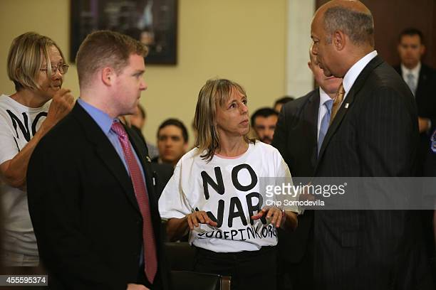 Homeland Security Secretary Jeh Johnson talks with Code Pink for Peace member Medea Benjamin before a House Homeland Security Committee hearing on...