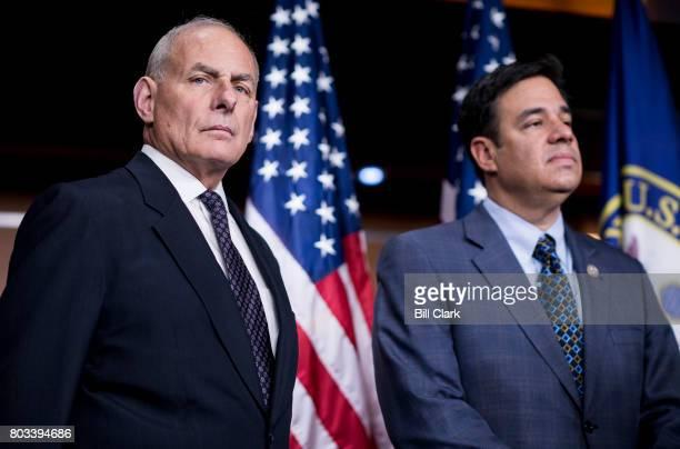Homeland Security Secretary John Kelly and Rep Raul Labrador RIdaho wait to address immigration legislation during Speaker of the House Paul Ryan's...