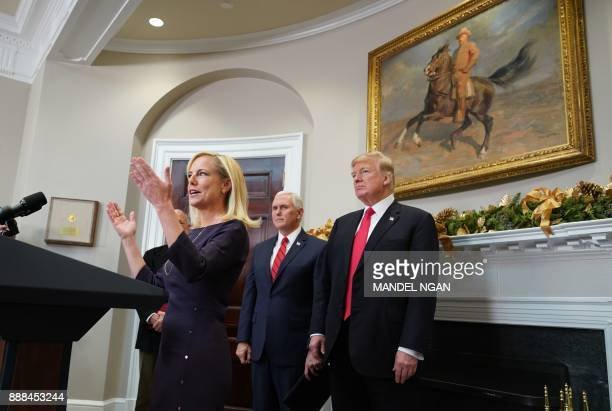 Homeland Security Secretary Kirstjen Nielsen speaks during her swearingin ceremony watched by US President Donald Trump and Vice President Mike Pence...