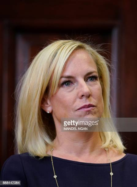 Homeland Security Secretary Kirstjen Nielsen watches as US President Donald Trump speaks during her swearingin ceremony in the Roosevelt Room of the...