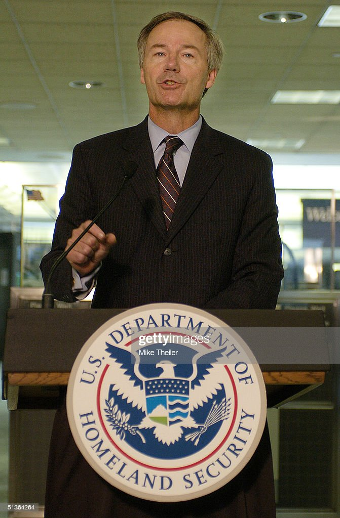 Homeland Security Undersecretary for Border and Transportation Security Asa Hutchinson speaks September 27, 2004 at Dulles International Airport in Washington, DC. Homeland Security is expanding its US-VISIT program in an effort to speed processing of foreign visitors while maintaining high security.