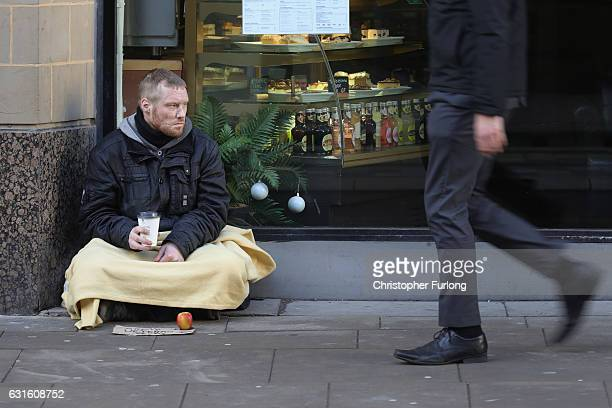 Homeless army veteran Phil begs for small change on the streets of Manchester on January 13 2017 in Manchester United Kingdom Many homeless people...