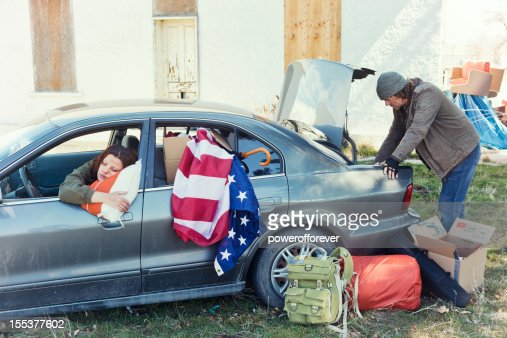 Homeless Couple Living Out of a Car