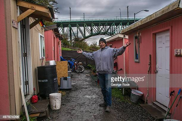 A homeless encampment known as Nickelsville located on steep muddy hillside next to Interstate 5 and 90 is viewed on November 3 in Seattle Washington...
