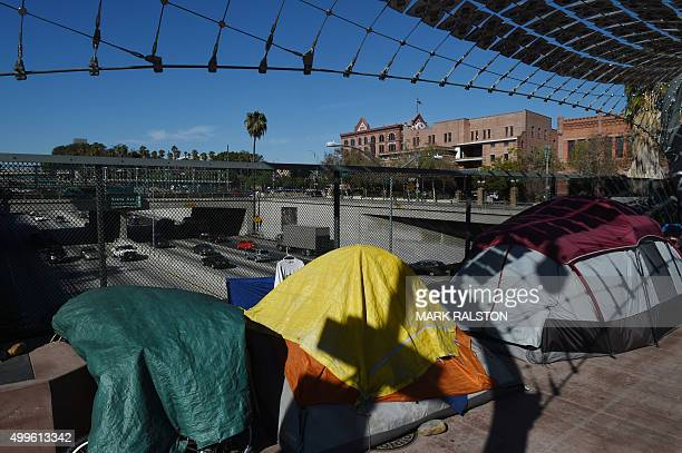 A homeless encampment on a freeway overpass near the Federal Building as a growing number displaced people spread out from downtown Los Angeles...