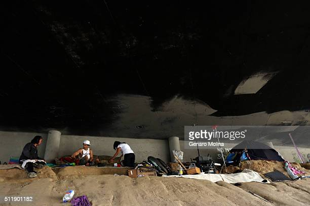 LOMITA CA FEBRUARY 23 2016 A homeless encampment underneath the 110 freeway in Lomita on February 23 2016 A joint operation of CalTrans LASO LAPD Los...