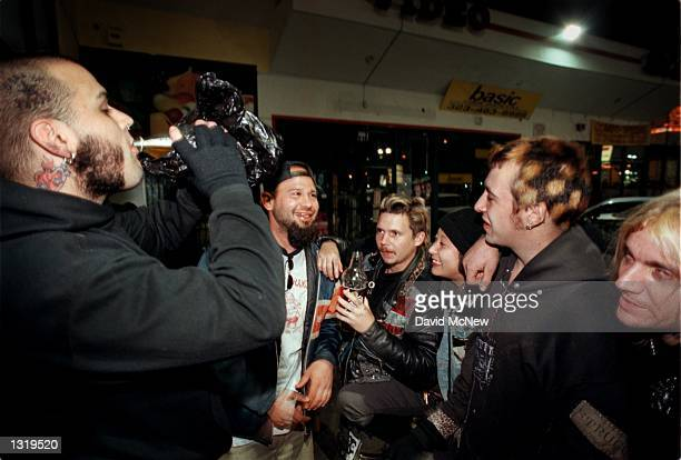 Homeless friends share beer that they bought with money they panhandled December 14 2000 in Hollywood CA Left to right are Meatball Daniel Booger...