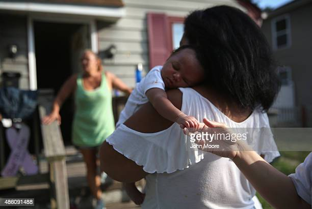 Homeless grandmother Valencia Terrell arrives with her grandchild to stay temporarily at a friend's home on August 26 2015 in Atlantic City New...