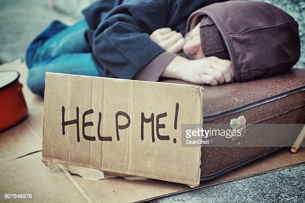 Homeless Holding Cardboard