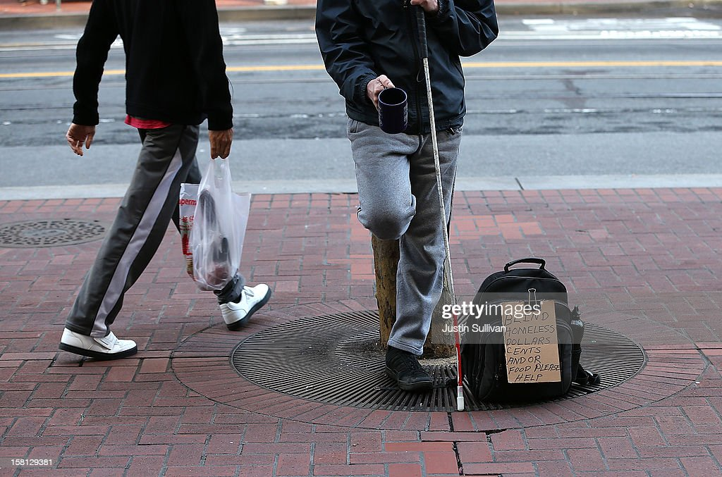 A homeless man begs for change on December 10, 2012 in San Francisco, California. Despite efforts from the Federal Government and local officials to provide more shelters and beds for homeless people, the number of people living on the streets remained unchanged from January 2011 to January 2012. The number of homeless families increased while the number of veterans on the street decreased.