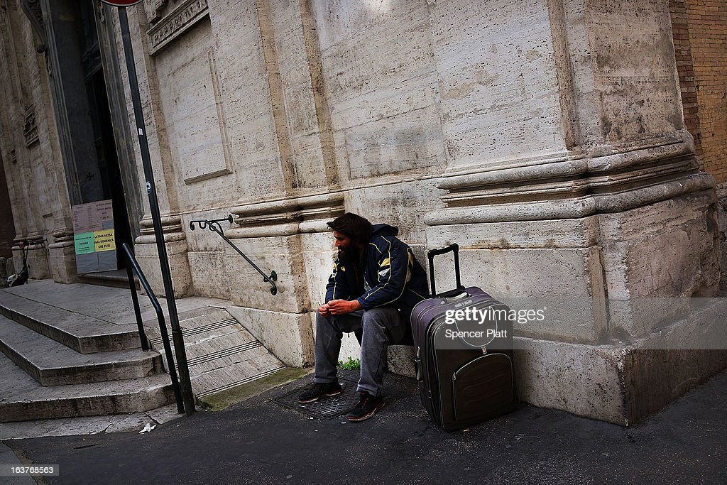 A homeless man begs for change on the steps of a Catholic church on March 15, 2013 in Rome, Italy. Newly elected Pope Francis, formerly Cardinal Jorge Mario Bergoglio of Buenos Aires, has been a strong advocate for the poor and disenfranchised throughout the world. A Jesuit, Francis has followed the tradition of his order whose members live spartan, communal lives of poverty. Many analysts believe his papacy will see increased outreach and advocacy for the poor.