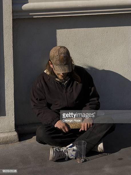 A homeless man begs for money in front of the Bellagio Hotel on the Las Vegas Strip in this 2009 Las Vegas Nevada winter afternoon exterior photo