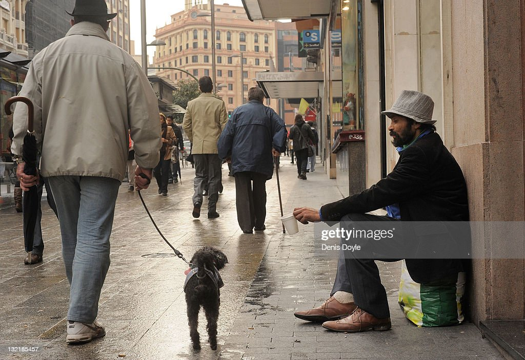 A homeless man begs on Calle Gran Via on November 10, 2011 in Madrid, Spain. The current Eurozone debt crisis has left Spain with crippling economic problems. Mounting debts, record unemployment figures and the recent credit rating downgrade is leaving the country facing further economic stagnation. The people of Spain are preparing to go to the polls for a general election which will be held on November 20, 2011.