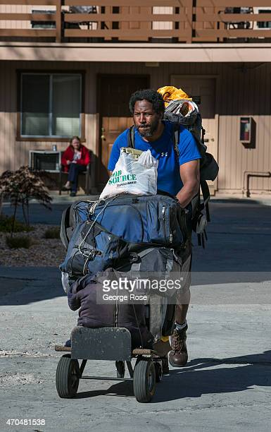 A homeless man carries all his belonging in a shopping cart on April 13 in Reno Nevada Reno located in the northwest corner of Nevada continues to...