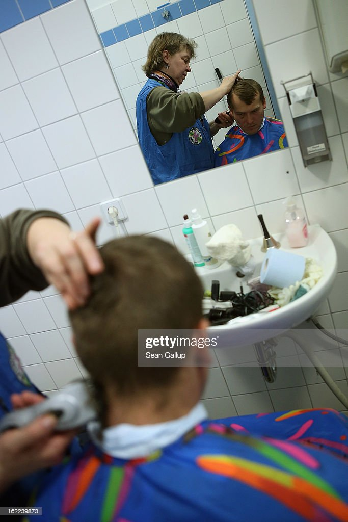 A homeless man from Lithuania gets a free haircut from Franziska in a bathroom after having a free lunch at the Bahnhofsmission Protestant charity facility at Zoo train station on February 20, 2013 in Berlin, Germany. The Bahnhofsmission feeds up to 600 needy men and women every day, up from 400 only three years ago. Approximately 60% of the visitors are from Eastern Europe, many of them workers in low-paying jobs who became unemployed and ran out of money. Dieter Puhl, who runs the Bahnhofsmission, says he is seeing a steady increase in the number of visitors, especially among older Germans whose pensions are insufficient for them to make ends meet. Poverty in Germany, defined as someone who makes less than 60% of the median wage, has risen steadily in recent years, and according to statistics 14% of people in Germany lived below the poverty line in 2010. Both poverty and pensions that have not kept up with the rising cost of living will be contested topics in federal elections scheduled later for this year.