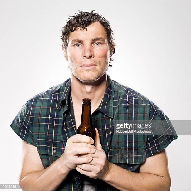 homeless man holding a beer bottle