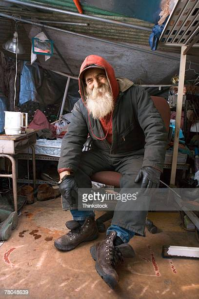 Homeless man in his shelter