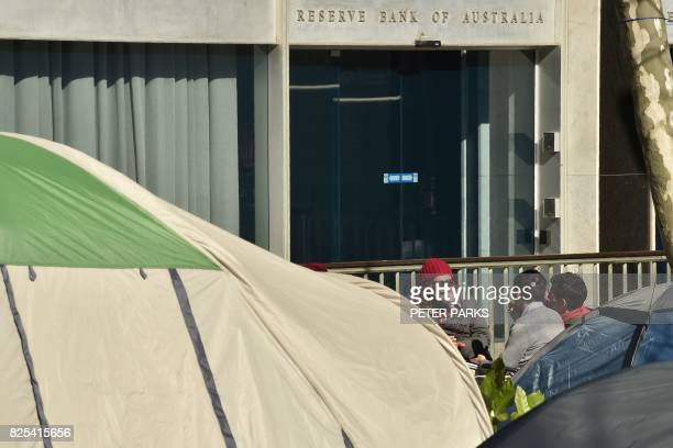 A homeless man is interviewed by the media outside his tent next to the Reserve Bank of Australia in Martin Place which has become known as 'Tent...