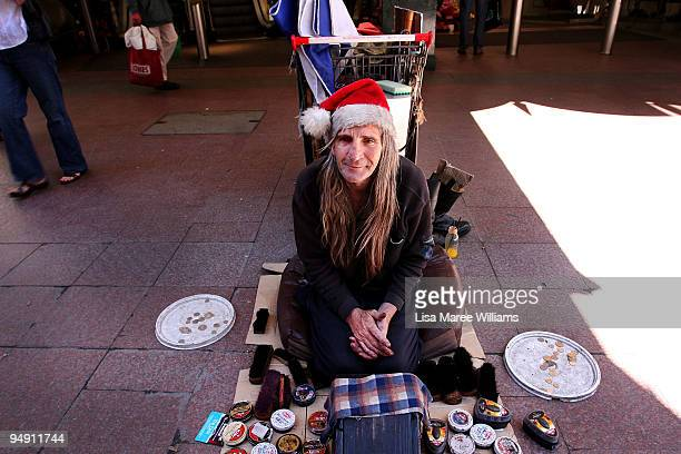 Homeless man known as 'Shoeshine Brian' awaits customers in Pitt Street Mall during the Christmas shopping period on December 19 2009 in Sydney...
