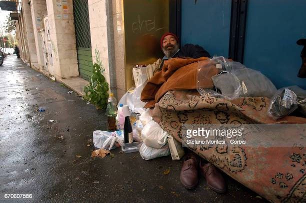 A homeless man lives on the street near the Park of Caffarella on January 24 2007 in Rome Italy