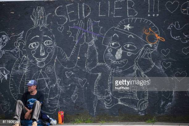 Homeless man near grafitti during G 20 summit in Hamburg on July 9 2017