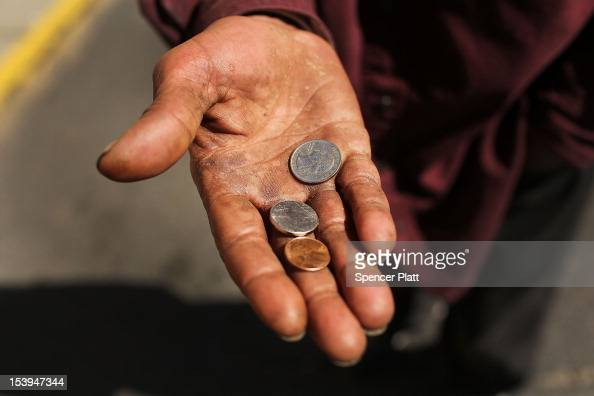 A homeless man panhandles on the street on October 11 2012 in Camden New Jersey According to the US Census Bureau Camden New Jersey is now the most...