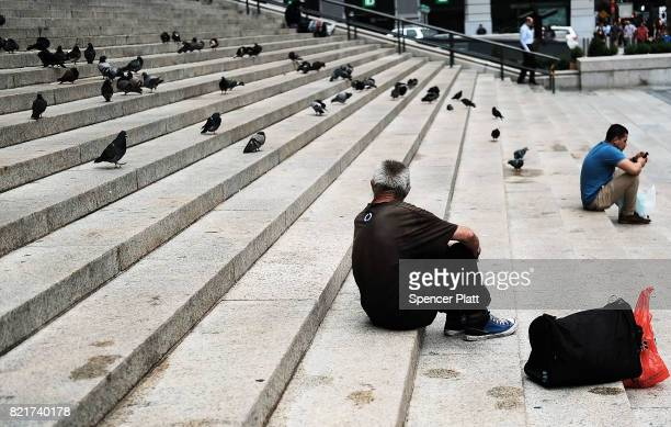 A homeless man pauses on a set of steps in Manhattan on July 24 2017 in New York City In its annual homeless count New York City recorded 3892 people...