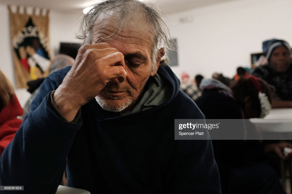 A homeless man prays at the Seashore Mission which offers services to the homeless and those in need on January 3, 2016 in Biloxi, Mississippi. According to the US Census Bureau, Mississippi is the nation's poorest state with a median income of $39,680. The city of Biloxi has struggled to make progress after the devastating flooding from Hurricane Katrina in 2005.
