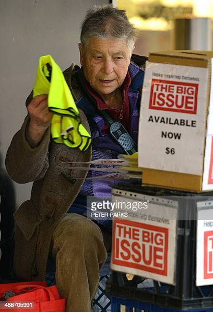 A homeless man prepares for a day selling The Big Issue a magazine sold by disadvantaged people on a street in Sydney on May 8 2014 Australia's...