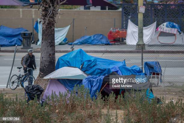 A homeless man returns to his encampment on May 1 2017 in Los Angeles California The newly released 2017 Greater Los Angeles Homeless Count indicates...