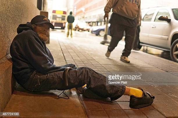 A homeless man sits in the street in downtown Philadelphia on October 22 2014 in Philadelphia Pennsylvania One of the nation's largest and most...