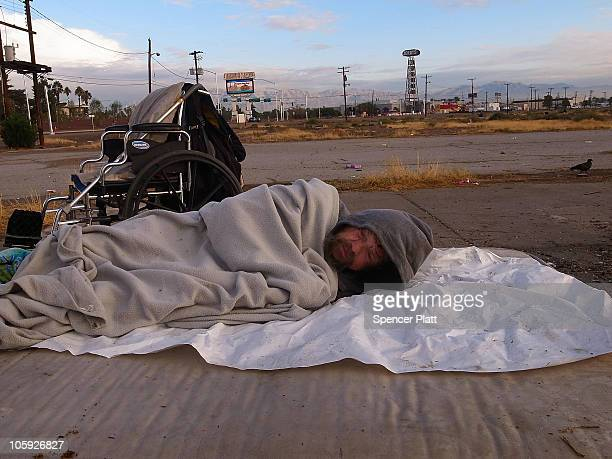 A homeless man sleeps at an encampment for the homeless along Las Vegas Boulevard on October 21 2010 in Las Vegas Nevada As of a 2009 census Las...