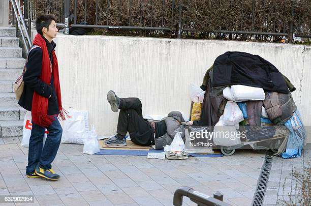 A homeless man sleeps at Tokyo's central Shinjuku Railway station in Tokyo Japan January 28 2017