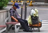 A homeless man sleeps on a bench in Seoul on July 26 2016 South Korea's economy posted improved growth in the second quarter as exports and domestic...