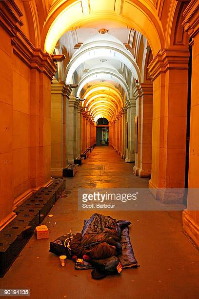 A homeless man sleeps on the street during the �Hands Up for the Homeless� campaign on August 31 2009 in Melbourne Australia The Hands up for the...