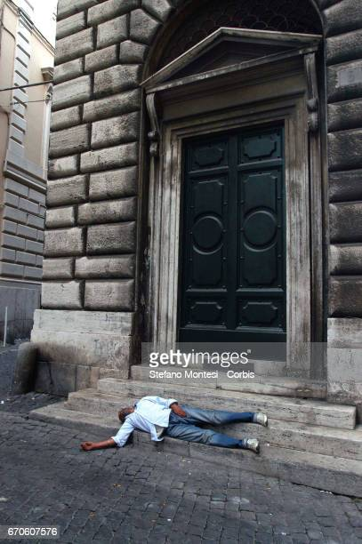 A homeless man sleeps on the street in via dei Fornari near Piazza Venezia on June 22 2007 in Rome Italy