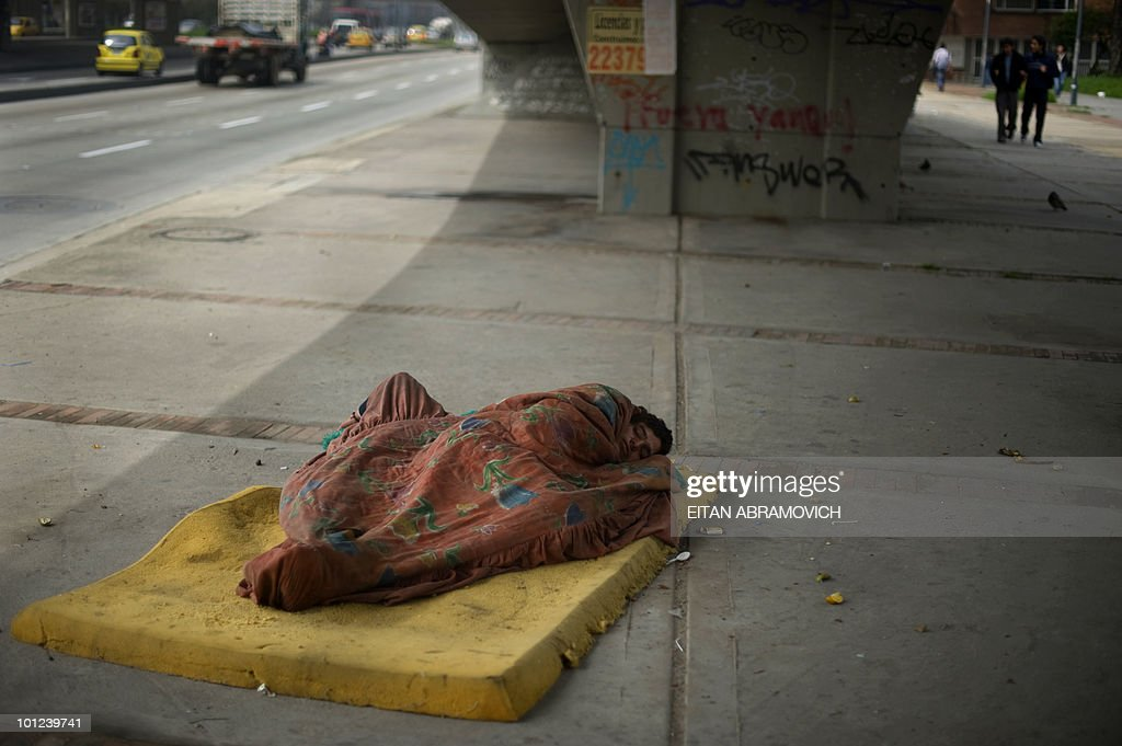 A homeless man sleeps under a bridge in Bogota, Colombia, a country in which 46% of the population live below the line of poverty, according to the 2009 United Nations Economic Commission for Latin America and the Caribbean report (ECLAC). AFP PHOTO/Eitan Abramovich
