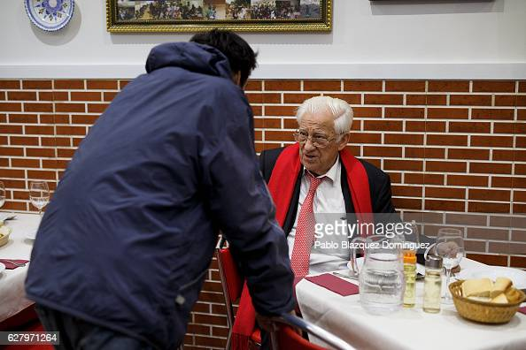 A homeless man speaks to Father Angel after he had a free dinner at Robin Hood restaurant on December 5 2016 in Madrid Spain Association Messengers...
