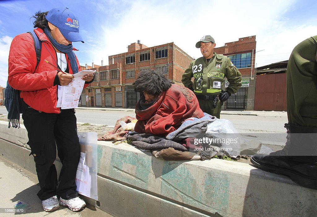Homeless man talks to the enumerator during the bolivian national census on November 21, 2012 in La Paz, Bolivia.
