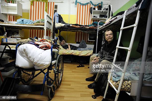 Homeless men are pictured on beds at a dosshouse in the Russia's second city of St Petersburg on January 13 2015 Each winter hundreds of people are...