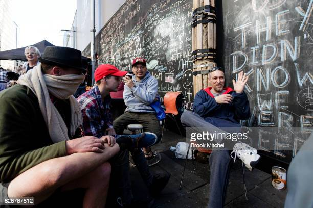 Homeless men living at Martin Place have a chat on August 6 2017 in Sydney Australia About 50 homeless residents face eviction after the state...