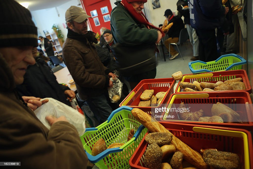 Homeless men take bread as part of a free lunch at the Bahnhofsmission Protestant charity facility at Zoo train station on February 20, 2013 in Berlin, Germany. The Bahnhofsmission feeds up to 600 needy men and women every day, up from 400 only three years ago. Approximately 60% of the visitors are from Eastern Europe, many of them workers in low-paying jobs who became unemployed and ran out of money. Dieter Puhl, who runs the Bahnhofsmission, says he is seeing a steady increase in the number of visitors, especially among older Germans whose pensions are insufficient for them to make ends meet. Poverty in Germany, defined as someone who makes less than 60% of the median wage, has risen steadily in recent years, and according to statistics 14% of people in Germany lived below the poverty line in 2010. Both poverty and pensions that have not kept up with the rising cost of living will be contested topics in federal elections scheduled later for this year.
