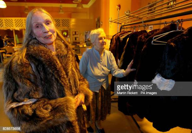 Homeless Peggy Bell and Maureen O'Riley choose fur coats that are being handed out by PETA at the YMCA in Liverpool The animal welfare charity which...